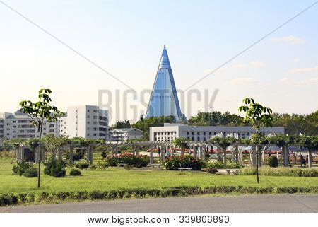 NORTH KOREA, PYONGYANG - SEPTEMBER 14, 2017: City garden and residential buildings near to Grand Monument Mansudae and Ryugyong Hotel, Pyongyang, capital city of the DPRK, North Korea