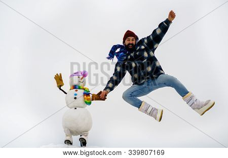 Bearded Man Playing With Snowman. Santa Claus Man With Snowman In Winter Hat. Man With Snowman. Fash
