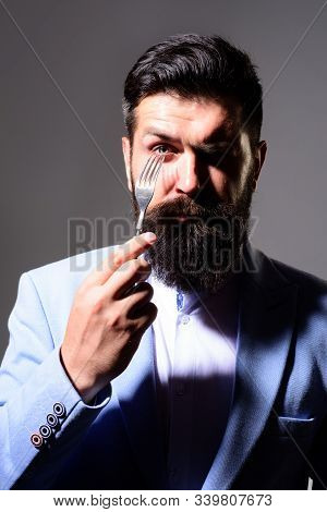 Bearded Man Holds Silver Fork. Businessman In Suit Holds Fork In His Hand. Handsome Bearded Man In S