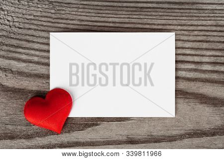 Valentine's day white blank paper greeting card and red silk hearts, background border frame with copy space, love concept