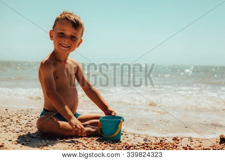 child playing on the seashore. red sea