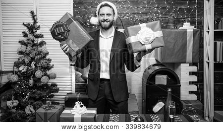 Which One Is Mine. Man Bearded Businessman Wear Suit Santa Hat Hold Gift Boxes. Christmas Gifts. Man