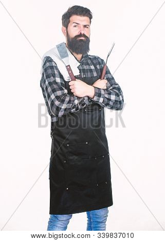 Barbecue Accessories. Bearded Man Holding Grill Gripper Tools. Hipster In Apron With Metal Utensils