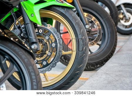 Bangkok, Thailand - December 15, 2019: Abs Disc Brake System Matched With Gold Enkei Mag Wheel On A