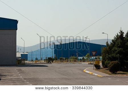 Outdoor View Of Bottle Storage Industrial Warehouse. . Concept For Glassworks Manufacturing Process