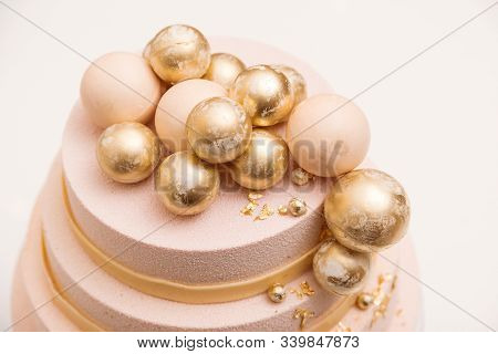Tiered Wedding Cake Decorated With Golden Balls. Luxury Decorated Cake For Anniversary, Birthday Ove