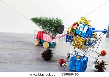 Shopping Trolley With Gifts In Chirstmas Shopping. Online Shopping Concept - Trolley Cart Full Of Pr