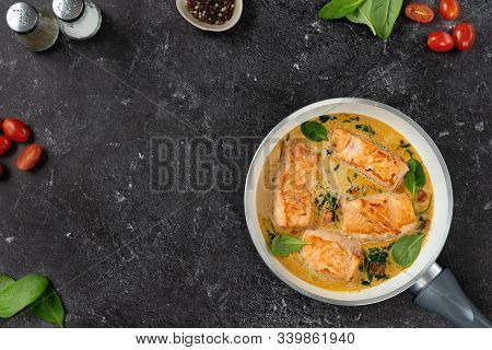 Delicious Salmon Steaks In Cream Sauce On Black Background
