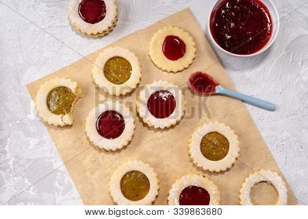Close Up Of Colorful Linzer Cookies On Light Background