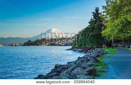A View Of Mount Rainier And The Shoreline In Ruston, Washington.