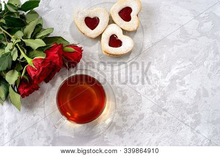 Cup Of Tea And Heart Shaped Cookies For Valentines Day