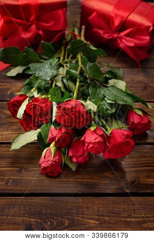 Red Roses, Gift Boxes, Linzer Cookies On A Dark Wooden Background