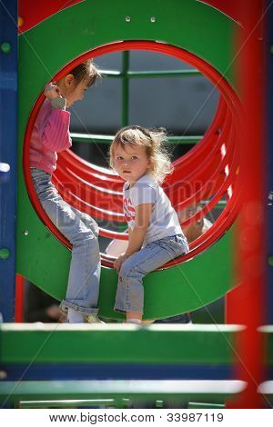 little child baby girl outdoors playing on playground