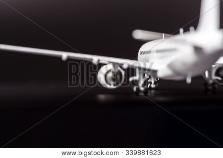 Blurred Silhouette Of A Passenger Plane On A Black Background : Business Travel Concept