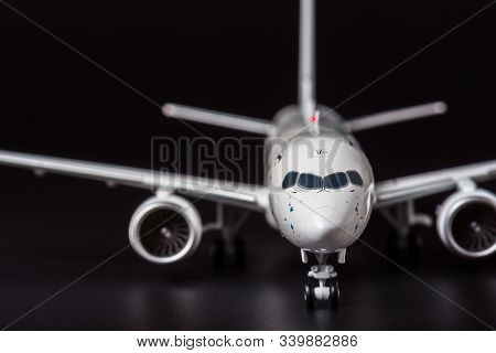 Private Airplane Model On Black Background. Front View Of Passenger Or Cargo Aircraft, Business Jet,