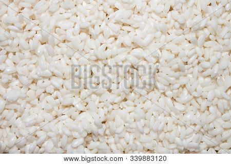 Round-grain Crumbly Rice.rice Groats.background Of Rice Grains.the Texture Of The Rice.