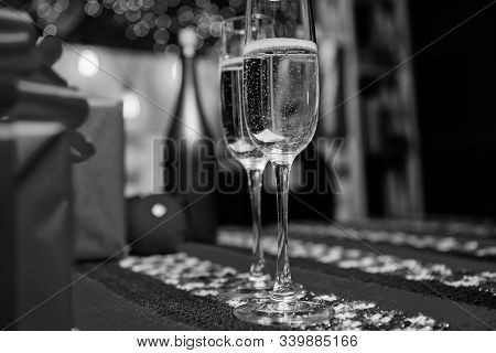 Glass Of Champagne Close Up. Champagne Couple Glasses. Glass Filled Sparkling Wine Or Champagne Near