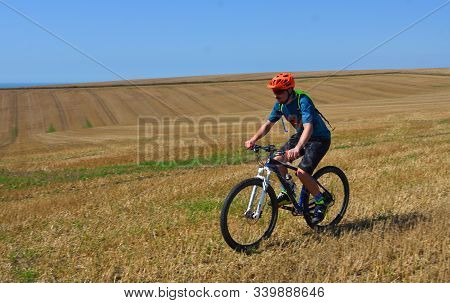 Alciston, East Sussex, England - September 01, 2018 : Male Mountain Biker Riding The South Downs Nea
