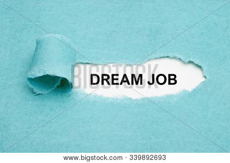 Printed Text Dream Job Appearing Behind Ripped Blue Paper. Concept About Finding The Perfect Dream J