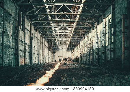 Abandoned Industrial Creepy Warehouse Inside Old Grunge Factory Building, Yellow Vintage Toned
