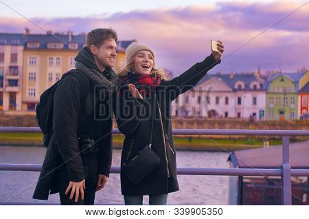 Happy Tourists Taking Photo Of Themselves. Holidays, Travel, Vacation, Tourism And Dating Concept. W