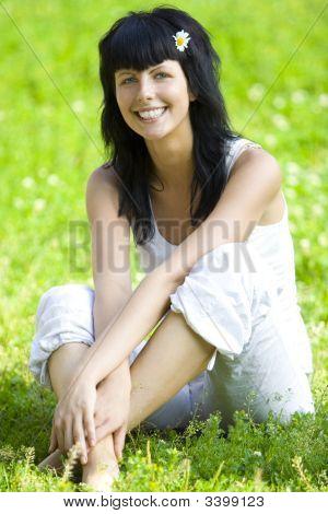 Woman Sitting On Grass