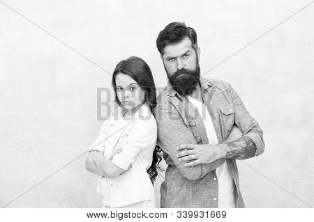 Trusting Relations. Little Daughter And Father Keeping Arms Crossed On Grey Background. Bearded Man