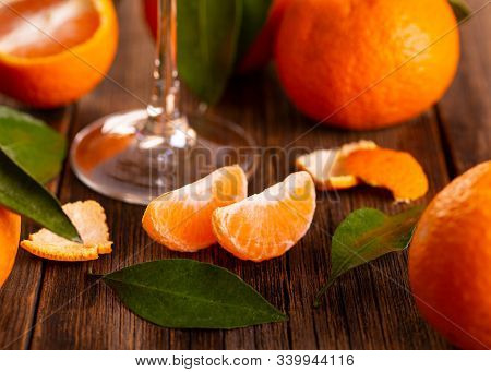 Still Life Of Fresh Tangerines. A Glass Of Champagne And Fresh Tangerines. Tangerines And A Glass On