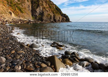 Waves Washing Onto Rocks At Coastline In Cinque Terre Italy
