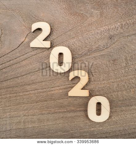 Happy New Year 2020 concept, Wood block 2020 on wooden background