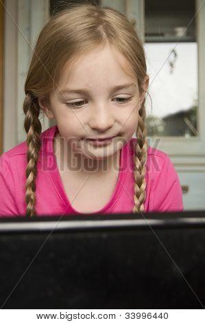 Happy Girl At Computer