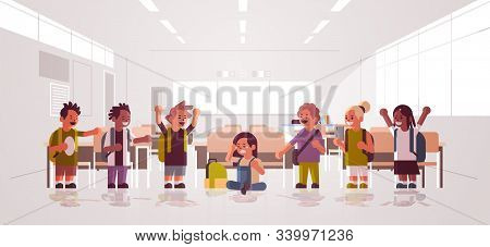 Schoolboy Being Bullied Sitting On Floor Surrounded By Classmates Mix Race Schoolchildren Taking Pho