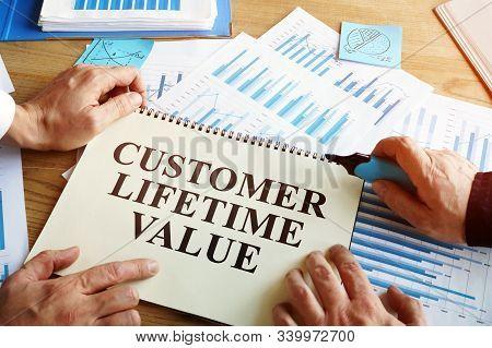 Men Read Customer Lifetime Value Conception In Book.
