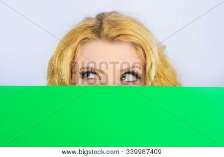 Smiling Woman With Blank Billboard. Blank Poster. Message Concept. Woman Hiding Behind Billboard.blo