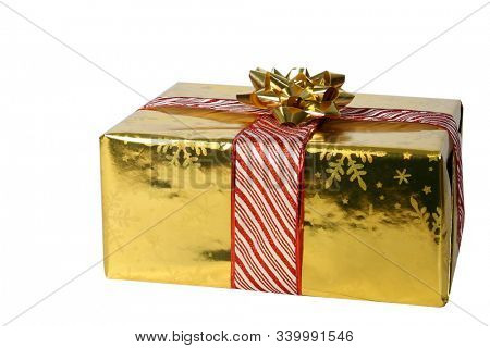 Christmas Gift. Gold wrapped Christmas Present. Isolated on white. Room for text. Christmas is the season for giving and receiving gifts from family and friends. Merry Christmas.