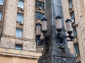 Lanterns on the decorative column of Ministry of Foreign Affairs building. One of seven stalinism skyscrapers. Low angle view. Moscow, Russia poster