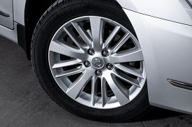 Novosibirsk, Russia - October 23, 2019:  Nissan Teana, Close-up Car Wheel With Aluminum Alloy Wheel