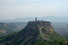 A Suggestive View Of The Town Of Civita Castellana Perched On A Crumbling Rock Spur