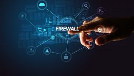 Hand touching FIREWALL inscription, Cybersecurity concept