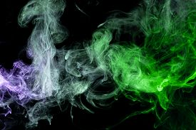 Frozen Abstract Movement Of  Explosion Smoke Multiple Blue And Greencolors On Black Background. Back