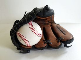 Close Up  View Of A White Baseball Ball Snow Coned At The Top Of A Tan Baseball Glove On A White Neu