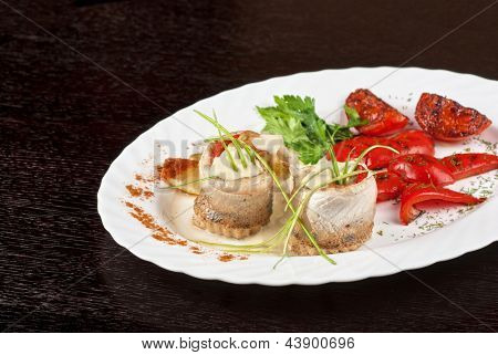 fillet of pikeperch stuffed with trout fish with baked pepper, tomato and leek
