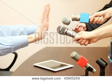 Conceptual photo of businessman or politician giving no comments