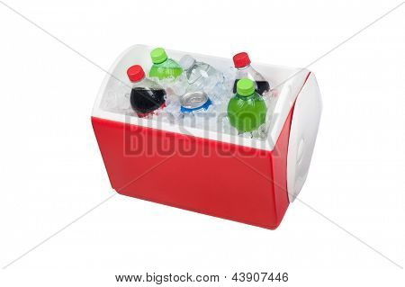 An isolated ice chest cooler filled with ice and soft drinks such as water and soda.