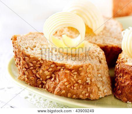 Butter on a Slice of Bread. Butter Rolls. Healthy Breakfast poster
