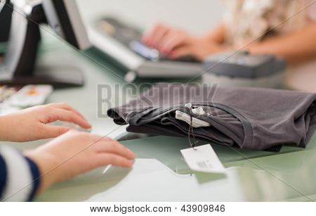 Woman At A Cash Counter, Indoors