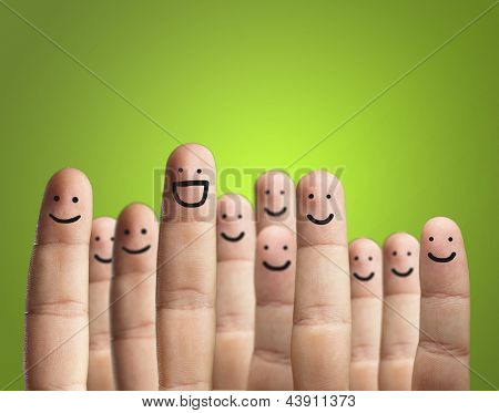 Close-up Of Fingers With Smiley Face Isolated On Green Background