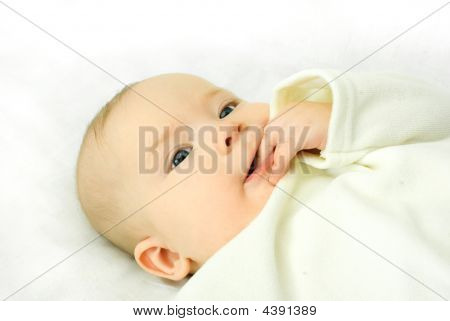 Cute Baby Lies On The Bed And Sucks His Fingers