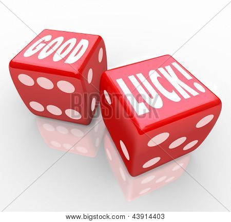 The words Good Luck on two red dice to encourage you to have good fortune and a favorable outcome in a game or effort