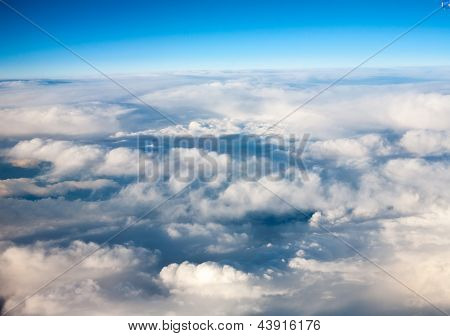 clouds. top view from  window of  airplane flying in  clouds. top view.